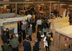 Guests gather in Superior Woodcraft's cabinet shop to network while sampling locally produced food, wine and beer.