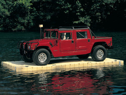 floating boat dock image with a 5000 pound hummer