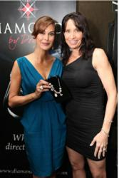 Teri Hatcher wearing the Diamonds by Donna Chocolate necklace and holding the Academy Award Inspired Signature Keepsake Series