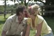 Actor Jason Smith and actress Anna Hutchison share a 'sticky' kiss.
