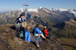 Hikers admire the mountain view in British Columbia, Canada