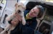 "Best Friends Animal Society dog trainer Whitney Jones comforts dog rescue team named ""Cilantro"""