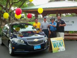 Ken Schork, El Monte RV rentals President, receives key to new Chevrolet as hole in one prize.