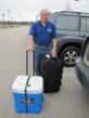 Dr. James McDaniel departs from Pounds Field Airport in Tyler, Texas, bound for Freetown, Sierra Leone. He carries an igloo cooler with vital medicine for the ship.