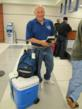 Dr. James McDaniel checking in at the Tyler Airport. One way Mercy Ships gets temperature-sensitive materials to their ship in Africa is via volunteers carry-on luggage.