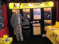 Michael Hoag, President of James Instruments Inc. at Conexpo 2011 with equipment being demonstrated