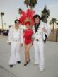 Claude Nielson, left, and Shane Paterson flank showgirl Betty King during the 21st annual Rural Roundup in Mesquite, Nev.