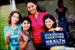 De La Cruz stands with another generation affected by health care reform