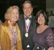 Medalists:  Mira Zivkovich and C. Warren Moses, CEO of The Children's Aid Society, with his wife at Ellis Island, NY