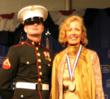 Medalist Mira Zivkovich with military officer after receiving 2007 Ellis Island Medal of Honor