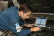 A technician using EDGE to service a vehicle
