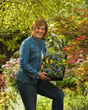 Melinda Myers with a flat of flowers in the garden.
