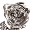 Bud of the Antiqued Silver Toned Kissing Rose Showing a Couple Kissing