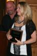 Kevin and Kathy Schneider accepting the Bosco Tourism Business of the Year Award on April 21, 2011