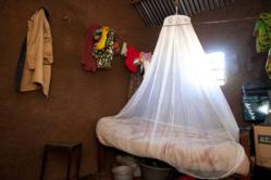Nuru International Kenya: treated bed net to prevent malaria. World Malaria Day