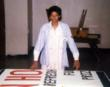 The sign lady, Eileen Garrett makes a banner for the YMCA.