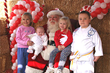 Santa Claus with young fans at 2nd Annual Thanksgiving Weekend Snowtacular at Tri City Shopping Center in Redlands, California