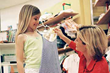 Mother and daughter shopping team browse the merchandise at Shaw Village Shopping Center in Fresno, California