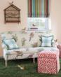 Bird print fabric sofa and Zebra striped ottomans.