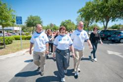 From left to Right - Dave Schandel CFO, Dr. Wendy Myers CEO, Dr. Joseph Zuckerman CMO leading employee walk around corporate facility