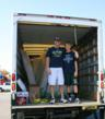 Lieutenant Ryan Smith and brother-in-law, Noah Clarkson age 15, pick up 20 mattresses for Travis County fire stations