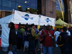 Crowds around the myAAEworld booth at last year's Penn Relays