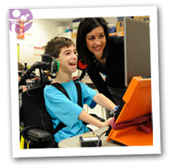 Teacher and student with disabilities working with technology