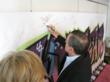 signing the celebrity wall for charity