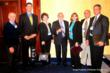 The Vanadium Redox Program team photo:  Ashlawn Energy Staff, Painesville City and Utility Managers, and the DOE energy storage program manager pose at the 2010 DOE Energy Storage Conference :  (l-r) Maurice Daniel (AE), Pierre-Yves Bertholet (AE), Rita McMahon, (PV) Dr. Imre Gyuk (DOE), Norma Byron(AE), Joseph Startari(AE), Paul Morton(PV)