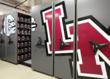The storage in each aisle is customized to fit items of all shapes and sizes such as the football team's helmets.