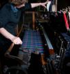 A D.C. Dalgliesh tartan weaver working on a traditional flying shuttle loom