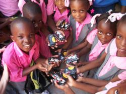 Children at an orphanage in Haiti receive soaps from The Walt Disney World Resorts courtesy of Clean the World.