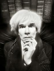 David LaChapelle, the post-modern pop photographer, was given his first job at Interview Magazine by Andy Warhol. For this portrait LaChapelle placed Warhol in front of a row of holy bibles, forshadowing the deity Warhol would become in the art world after his untimely death.