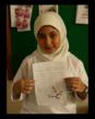 A young Indonesian student displays her drawing of a cockatoo as part of the program of the Indonesian Parrot Project to instill pride in their wonderful parrots.