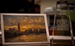 Photoshop Guru Awards Winning Photo and Trophy