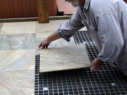 Tile placed on structural underlayment with flexible adhesive.
