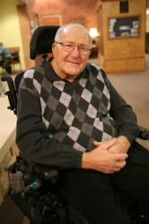 John Albers, in his wheelchair as a result of mixing up his medications.