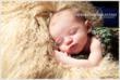 Newborn Sleeps on Lambskin Pillow by NJ Newborn Photographer Christine DeSavino