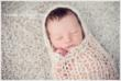 Newborn in Peanut Wrap by Newborn Photographer Christine DeSavino