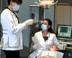 Dentist and Hygienist with Patient