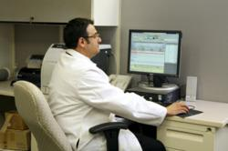 Dr. Fadi Layous reviewing a sleep study.
