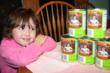 Young Wisconsin native Hailey admiring her photo on a Frank's Sauerkraut label