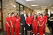 President Tedd L. Mitchell, M.D., and Regional Dean Pearl Merritt, Ed.D., R.N., stand with Abilene nursing students at the announcement of the new nursing facility in Abilene.