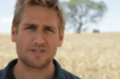 Curtis Stone standing in a wheat field