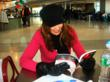 A fan of the Don't Spoil Your Appetite Series displaying her new copy at a book signing in a New Jersey Airport