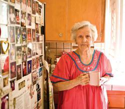 Elderly woman in her kitchen