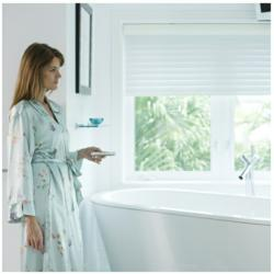 Motorized bathroom window coverings add convenience while preserving privacy and enhancing safety.
