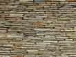 Acoustifence-Landscape attachment featuring a rustic stone wall
