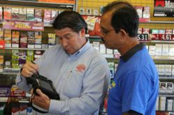 Ben E. Keith sales rep uses MobileDemand Rugged Tablet PC for beer sales at retail store.