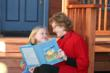 Grandma and Granddaughter share their book.